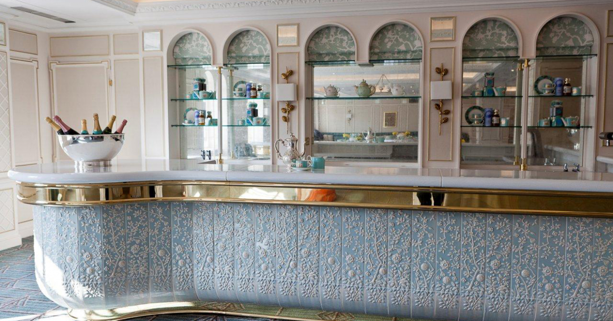 The acrylic tiles on the bar front were glazed to match Fortnum & Mason's brand colours