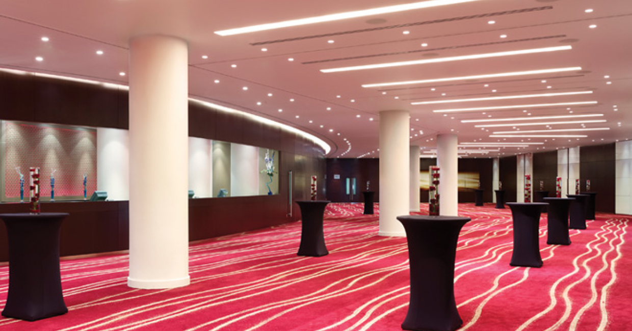 Carpet pattern and lighting has been used to encourage people to traverse an internal space at the Park Plaza Westminster Bridge hotel, London