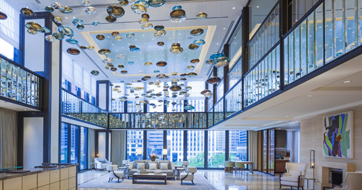 The lobby at The Langham, Chicago, is now adorned with two elegant and expansive light installations by Lasvit