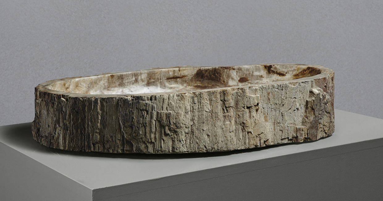 Made from fossilised trees, millions of years old, Lapicida's petrified wood basins are one-off works of art.