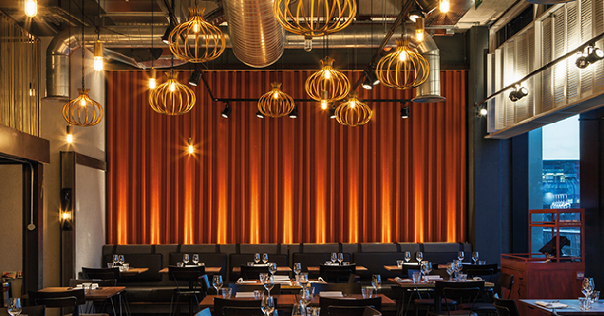 DesignLSM has created a striking urban-style interior for Rohit Chugh's second restaurant, Chai Ki, in Canary Wharf.