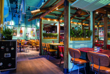 Caribbean Smokehouse opens with retro-vibe interiors by B3 Designers